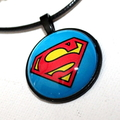 Glass pendant with Superman design