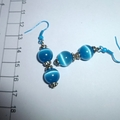Blue Mexican Opal earrings with silver spacers and matching blue ear wires.