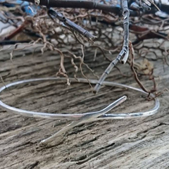 A beautiful accident, sterling silver bangle created when the solder kept jumpin