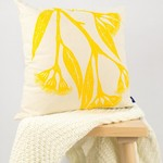 Cushion cover with Gum Blossom print in yellow. 40cm square.
