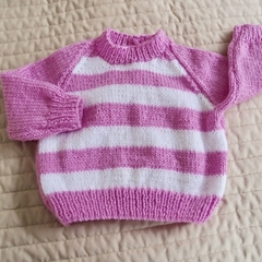 Size 3-9 months hand knitted jumper;  girl, washable,