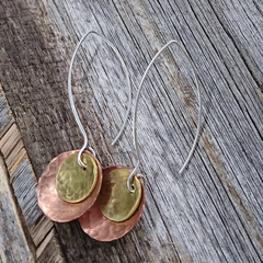 Hammered copper domes, recycled copper and brass, silver wires.