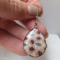 Orange, Navy and White Floral Print 18 x 25mm Resin Earrings hung from nickel fr
