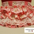 """""""Fancy Pants"""" in pink and white floral 'patchwork' cotton. Size 1"""