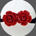 Hand carved red coral roses set on  sterling silver posts