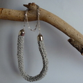 French knitted grey necklace on silver chain