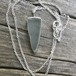 Genuine sea glass pendant with sterling silver chain.