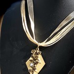 Blossom Pendant with 2 Swarovski crystals and a brass backing and