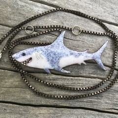 Enameled happy shark pendant.