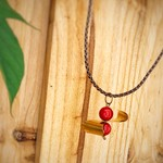 Dual worked brass with red wooden bead pendant