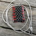 Enameled Red belly black snake skin pendant.