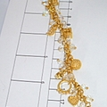Knock out gold and crystal charm bracelet.