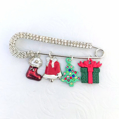 Silver scarf pin or brooch with Christmas charms.