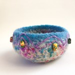 Unique round blue and rainbow coloured felt jewellery bowl. Hand  painted beads.