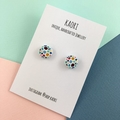 Handcrafted polymer clay stud earrings in colourful rainbow spots