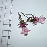 Acrylic, lucite and bronze earrings. Pink , green bronze trim, patina stamen