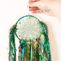 Small green dreamcatcher with tassels and ribbons