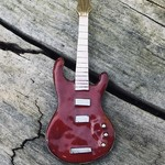 Enameled Red electric guitar brooch.