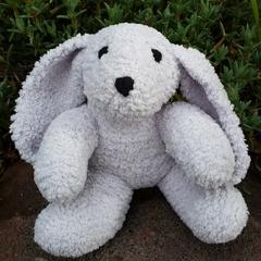 Bunny soft toy. Hand knitted, cuddly, floppy eared, grey  softie.