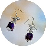 AB purple faceted crystals with silver bird on top