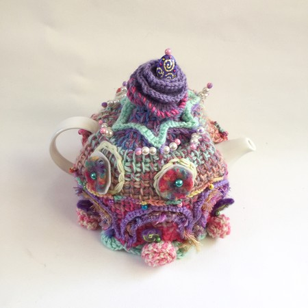 Unique embellished crochet tea cosy with floral theme. Pretty. Colourful. Beads.