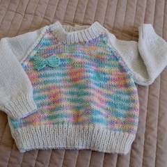 Size 0-6months hand knitted jumper; girl, washable