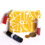 Zippered pouch coin purse in citrus and white fabric