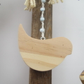 driftwood wreath with hanging wooden bird..