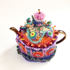 Unique embellished crochet tea cosy. Rainbow colours. Beads and buttons. Felt. .