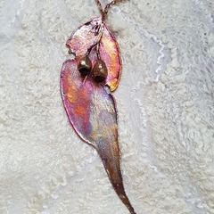 Real gum leaf and nut pendant.