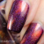 "Nail polish - ""Dormant Fractures"" A dark purple holo with a copper magnetic effe"