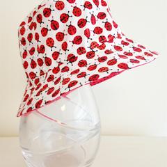 Girls wide brim summer hat in mini ladybug fabric