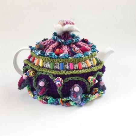 Unique crochet tea cosy with colourful embellishment. Beads. Felt. flower.