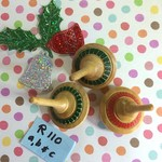 Three Spinning Tops with Christmas Colours (Items R 110 a,b & c)