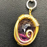 6.92 carat Oval Natural Amethyst in woven brass setting