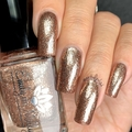 """Nail polish - """"Chrome Buttons"""" A pale rose gold with silver metallic flakes."""