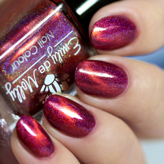 "Nail polish - ""Today At Noon"" A dark pink holo with a copper magnetic effect"