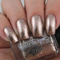 "Nail polish - ""Chrome Buttons"" A pale rose gold with silver metallic flakes."