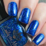 "Nail polish - ""Just Your Type"" A dark blue base with iridescent flakes"