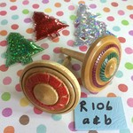 Two 'Christmas Colours' Spinning Tops (Items R 106 a & b)