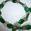 Malachite beads with silver butterflies.