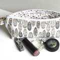 White gold and black leaves zippered pouch and makeup bag