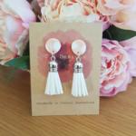 White & beige leather tassel earrings
