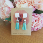 White & aqua leather tassel earrings