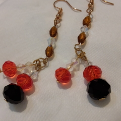 Fire orange and black dangle earrings.