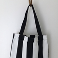 Modern tote bag in wide black and white stripes.
