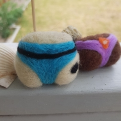 Felt bums!  Fridge magnet or keyring.