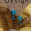 Turquoise pearl dangle earrings.