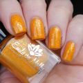 "Nail polish - ""Trips Abroad"" A bright sunflower yellow/orange with flakes"