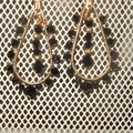 Gold toned black and gold chandelier earrings, wire wrapped Swarovski black crys